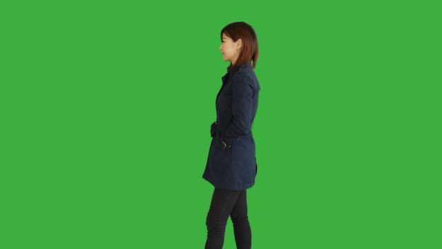 Young-Asian-Women-Standing-Isolated-Against-Green-Screen-Background-Portrait-of-Chinese-Female-Person-