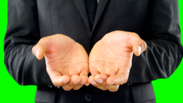 Businessman-pretending-to-hold-an-invisible-object-4k