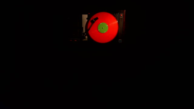 Vinyl-record-pleer-Plays-song-from-an-old-turntable-4k-top-view-