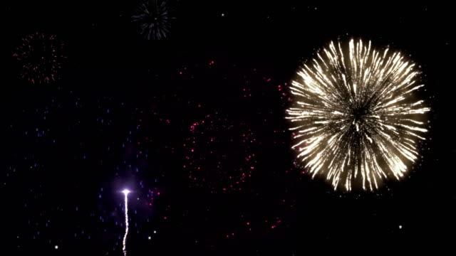 Celebration-greeting-firework-particles-night-sky-motion-fireworks-background-