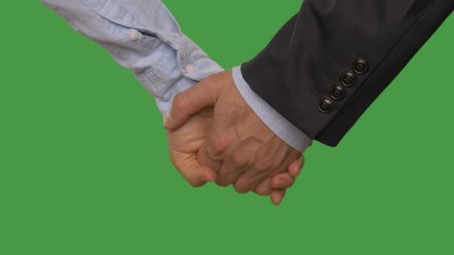 Man-hand-holding-female-hand-close-up-isolated-on-green-background-Alpha-channel-keyed-green-screen