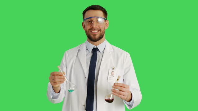Mid-Shot-of-a-Scientist-Wearing-Protective-Glasses-Mixing-Chemicals-in-a-Beakers-Background-is-Green-Screen-