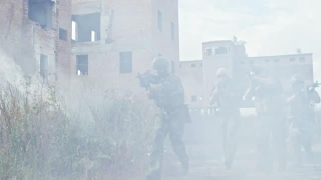 Armed-Squad-Running-through-Smoke-with-Shotguns