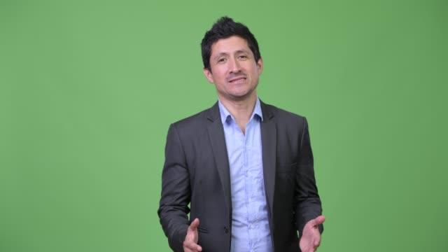 Hispanic-businessman-talking-and-promoting