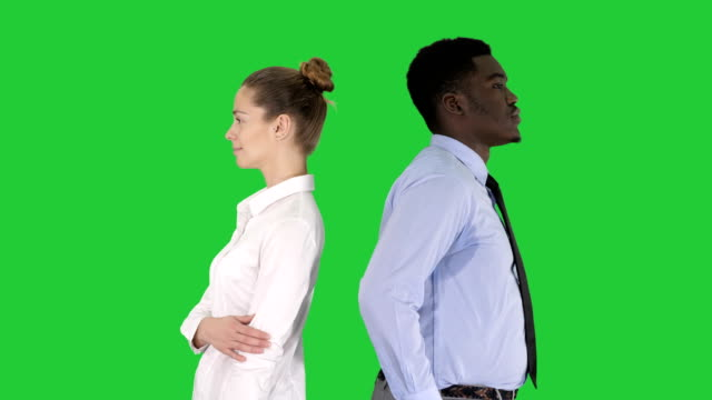 Beautiful-and-handsome-guy-standing-back-to-back-changing-poses-on-a-Green-Screen-Chroma-Key