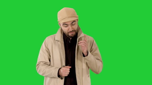 Handsome-young-thoughtful-man-has-a-wonderful-idea-on-a-Green-Screen-Chroma-Key