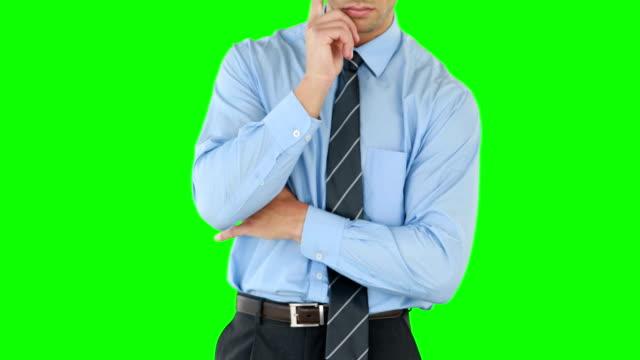 Thoughtful-businessman-using-an-invisible-board
