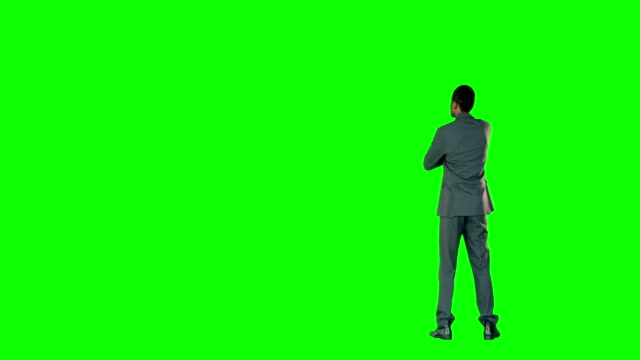 Businessman-pointing-on-a-green-screen