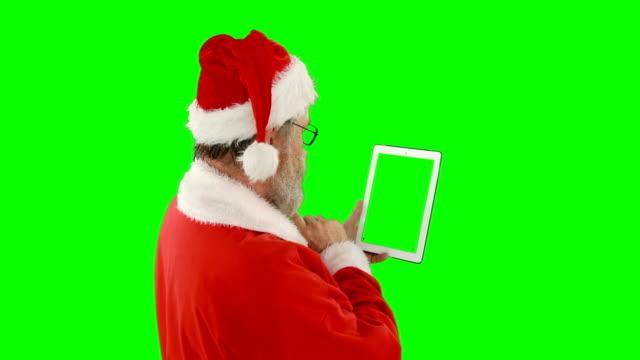 Santa-claus-mit-digitalen-tablet