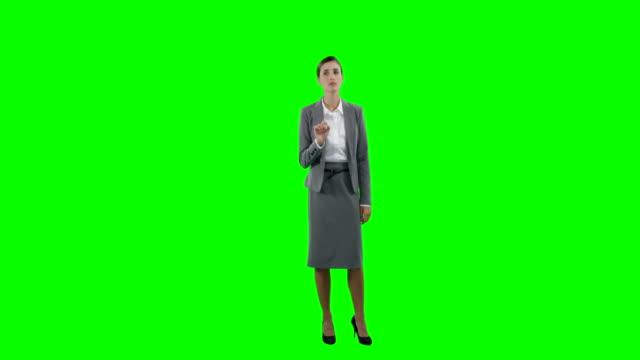 Businesswoman-touching-futuristic-digital-screen