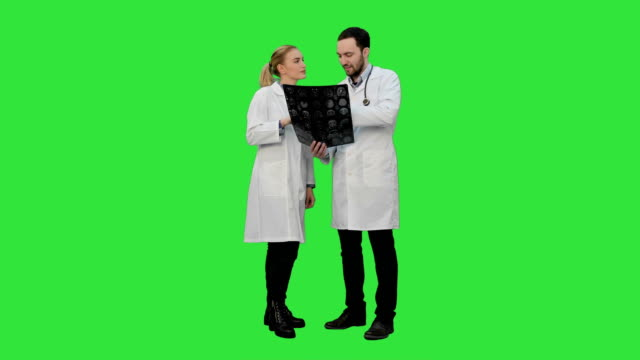 Doctors-examine-xray-and-discuss-successful-result-of-operation-on-a-Green-Screen-Chroma-Key