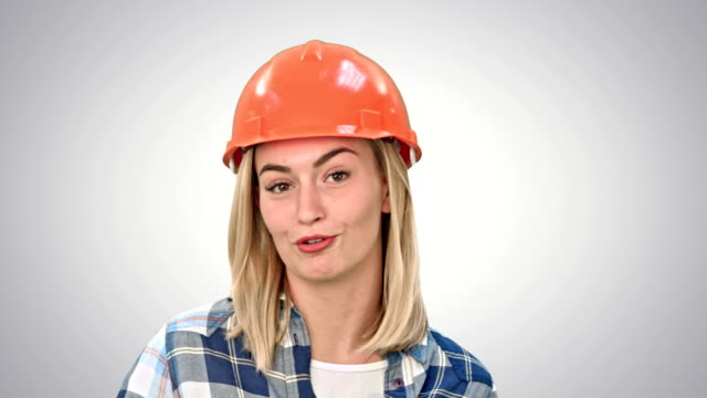 Construction-worker-talking-to-camera-on-white-background