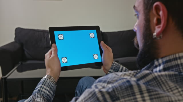 Man-with-a-Digital-Tablet-with-Blue-Screen-Motion