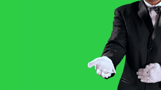 Tuxedo-Man-Gestures-Open-Hand-Reveal-to-Center-Screen-Green-Screen