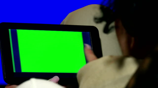 Girl-Using-Tablet-PC-with-Green-Screen-4K-UHD-stock-video-alpha-luma-matte-included