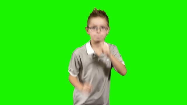 Little-boy-runs-at-green-background