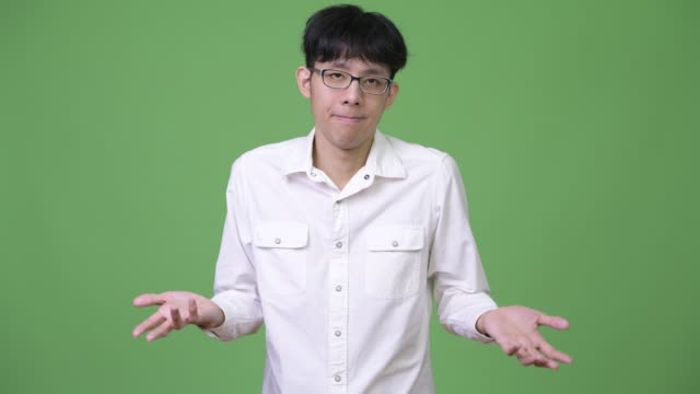 Young-Asian-businessman-shrugging-shoulders