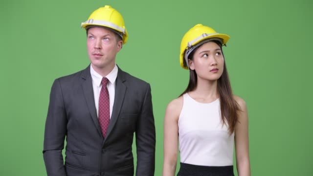 Multi-ethnic-business-couple-as-engineers-together