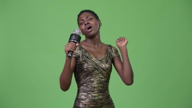 Young-beautiful-African-woman-using-microphone