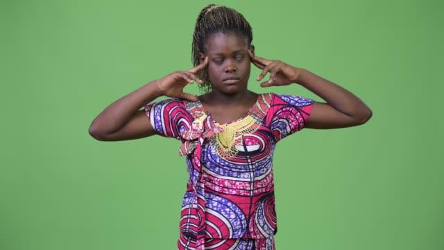 Young-African-woman-having-headache