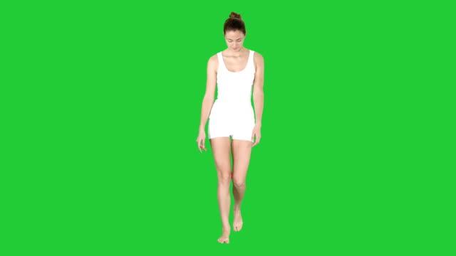 Slim-Model-Walking-In-White-Lingerie-on-a-Green-Screen-Chroma-Key