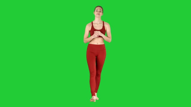 Beautiful-young-yoga-instructor-talking-to-camera-on-a-Green-Screen-Chroma-Key