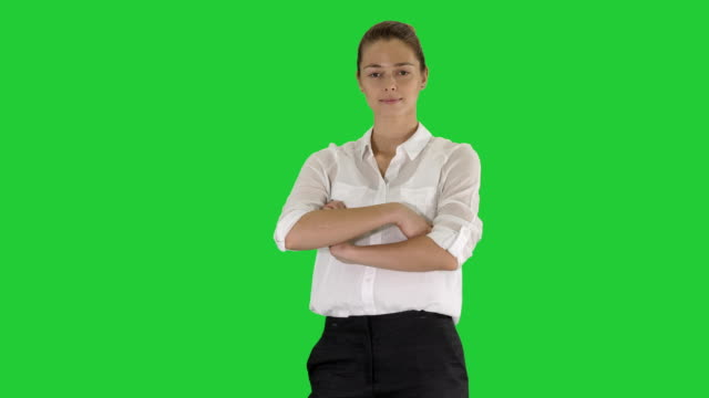 Beautiful-young-woman-in-formal-shirt-crossing-arms-on-a-Green-Screen-Chroma-Key
