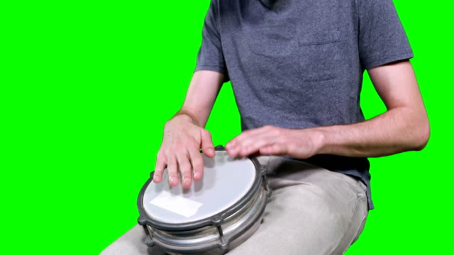 Mid-section-of-drummer-playing-drum