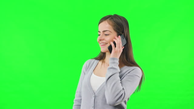 Woman-isolated-on-green-screen-with-phone