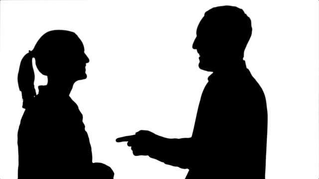 Silhouette-Handsome-man-and-attractive-young-woman-talking-and-smiling