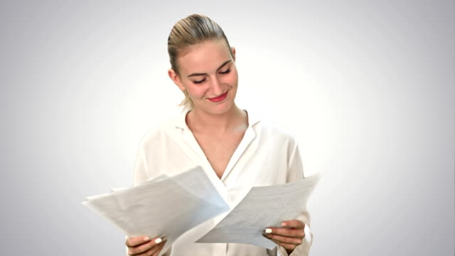 Happy-woman-finish-project-and-throws-scraps-of-paper-on-white-background