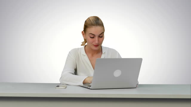 Young-secretary-tired-at-work-place-yawn-on-white-background