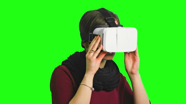 Woman-Turning-her-Head-with-a-VR-Headset-On