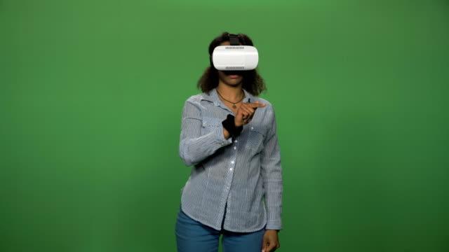 Black-female-using-VR-glasses
