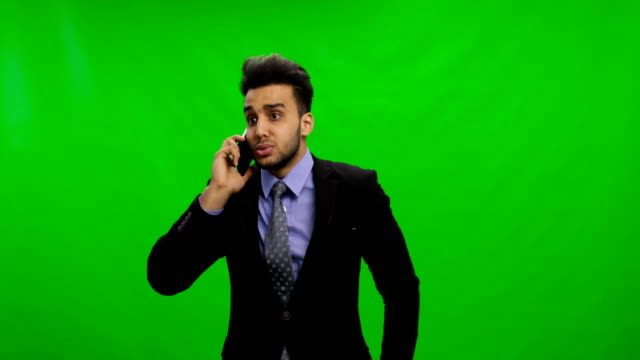 Sad-Young-Businessman-Calling-On-Phone-Over-Chroma-Key-Green-Screen-Latin-Business-Man-Solving-Problems-Serious-Crisis