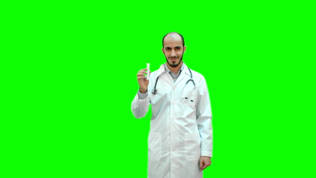 Young-doctor-presenting-brand-new-medicine-on-a-Green-Screen-Chroma-Key