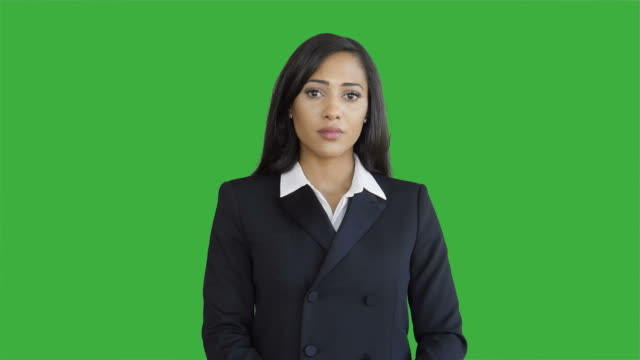 Lifestyle-Portrait-of-Young-African-American-Business-Woman-Isolated-on-Green-Screen-Chroma-key-Background