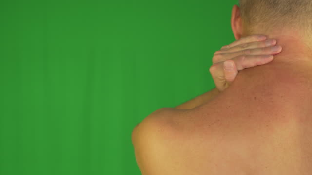 Man-rubbing-neck-and-shoulders-with-right-hand-Extreme-close-up-back-view-Locked-shot-