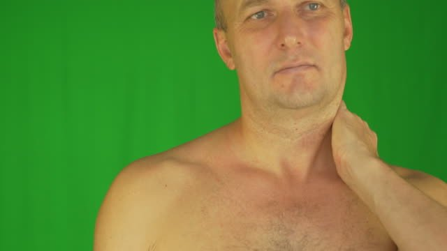 Man-rubbing-neck-and-shoulders-with-left-hand-Extreme-close-up-front-view-Locked-shot-