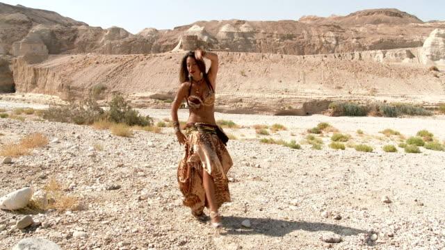 Beautiful-female-dancer-Belly-dance-Desert-Sexy-golden-brown-dress-dancing-Long-shot-up-