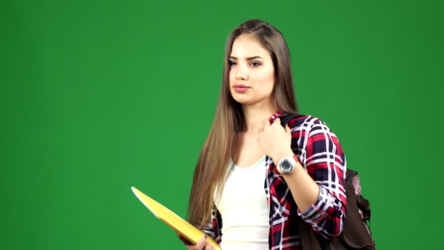 Young-beautiful-female-student-with-a-backpack-smiling-to-the-camera