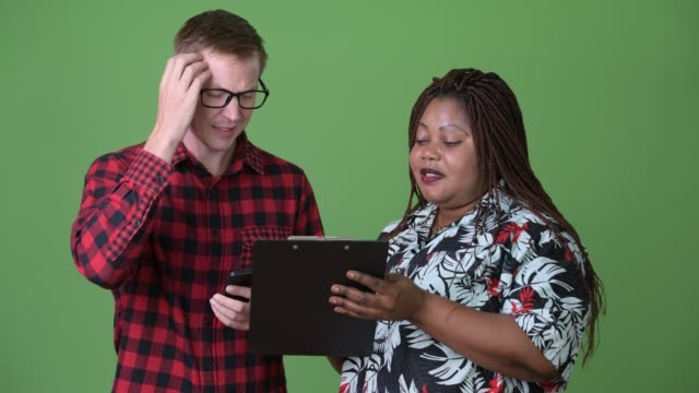 Overweight-African-woman-and-young-Scandinavian-man-together-against-green-background