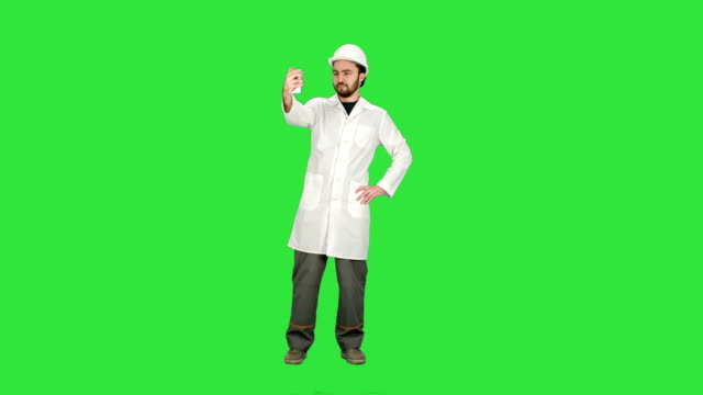 Engineer-or-architect-taking-a-selfie-showing-gesture-on-a-Green-Screen-Chroma-Key