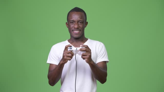 Young-excited-African-man-playing-games