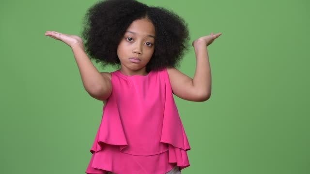 Young-cute-African-girl-with-Afro-hair-shrugging-shoulders