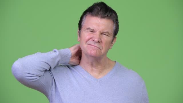 Senior-handsome-man-having-neck-pain