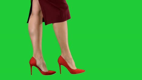 Sexy-woman-legs-in-red-heels-walking-Business-lady-on-a-Green-Screen-Chroma-Key