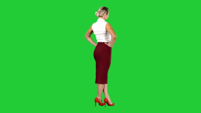 Woman-putting-her-hands-on-her-hips-on-a-Green-Screen-Chroma-Key