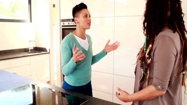 Lesbian-couple-having-an-argument-in-the-kitchen