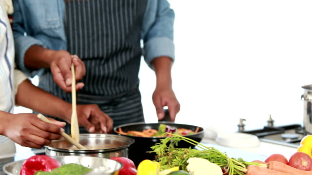 Happy-young-couple-cooking-together